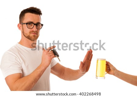 Man refusing alcohol beer showing car key as gesture of don't drink and drive isolated over white. - stock photo