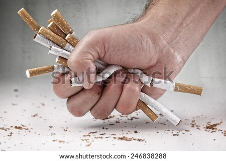 Man refusing cigarettes concept for quitting smoking and healthy lifestyle - stock photo