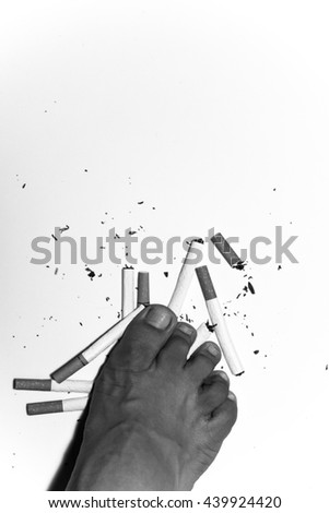 Man refusing cigarettes with space on top for text, Concept for stop smoking cigarette and healthy lifestyle , monochrome - stock photo