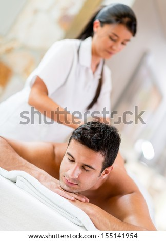 Man relaxing at the spa getting a massage