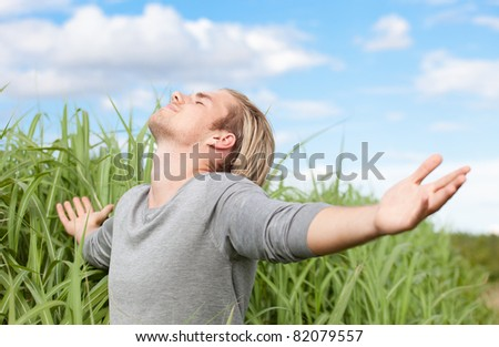 man relaxing grass and clouds - stock photo