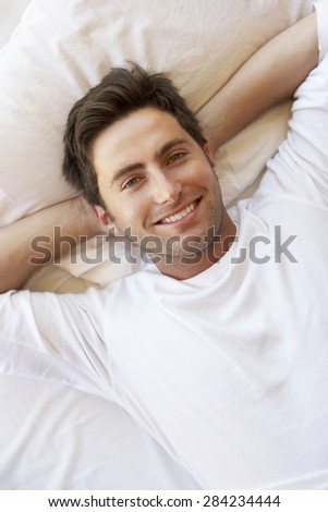Man Relaxing In Bed - stock photo