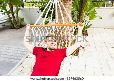Man Relaxing In Hammock  - stock photo