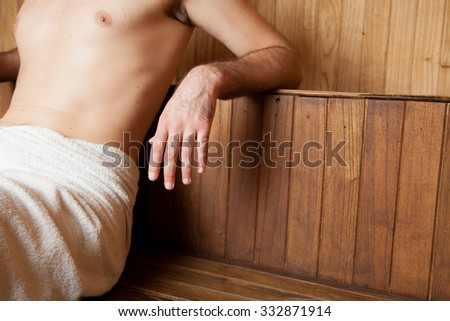 Man relaxing in the sauna - stock photo