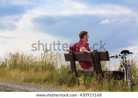 Man relaxing on a wooden bench