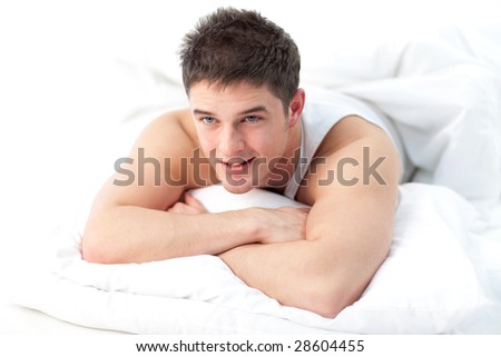 Man relaxing on bed awake