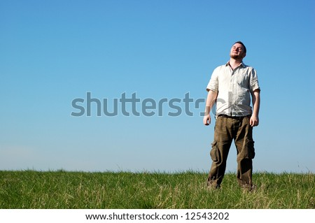 man relaxing on sky background