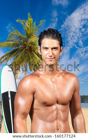 Man relaxing on the beach at exotic resort with wind surf board on background