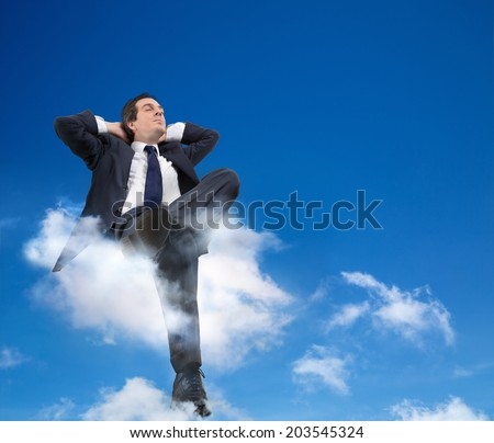 man relaxing with head in the clouds