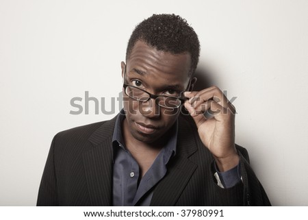 Man removing his glasses