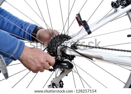 man repairing bicycle wheel - stock photo