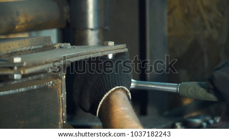Man repairing gas cutting. Clip. Man fixes the barrel machines for metal pressing. Repair industrial machines