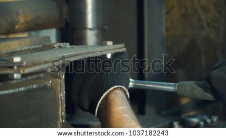 Man repairing gas cutting. Clip. Man fixes the barrel machines for metal pressing. Repair industrial machines