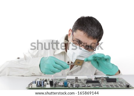 Man repairing microchip electronic equipment on white background - stock photo