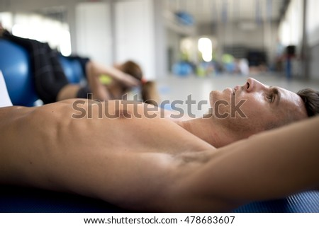 Man resting after exercises at gym