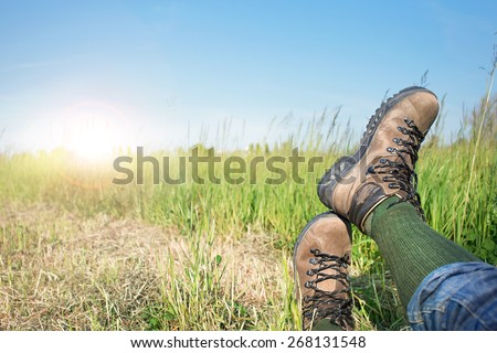 Man resting after hiking excursion in the nature - stock photo