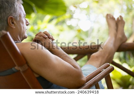 Man Resting in a Chair - stock photo
