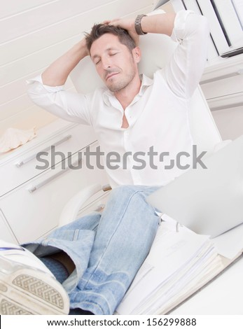 Man resting in the office.  - stock photo