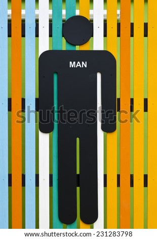 Man restroom sign on colorful wooden