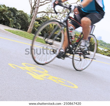 man riding a bicycle in the park, selective Focus - stock photo