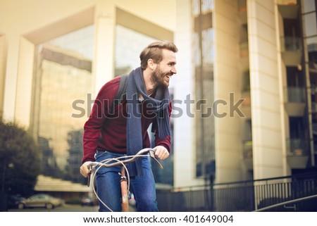 Man riding a bike - stock photo