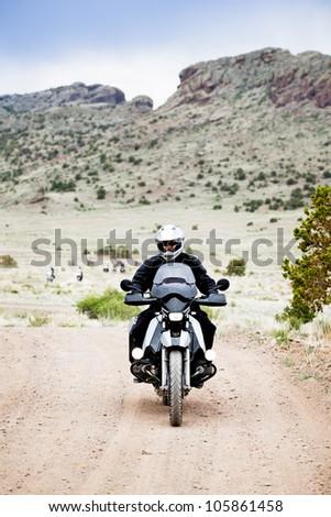 Man riding a Bike through the mountains of Colorado - stock photo