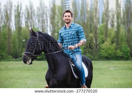man riding a horse - stock photo