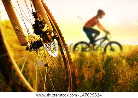 Man riding a mountain bike - stock photo