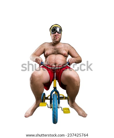 Man riding a small bicycle - stock photo