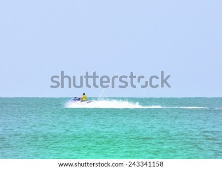 Man riding jet-ski enjoying a nice summer day. - stock photo