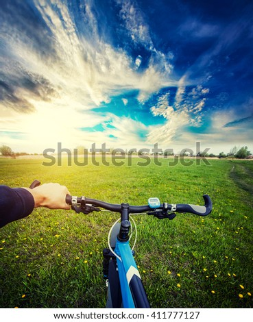 Man riding on a bicycle in summer a meadow