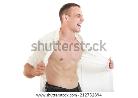 Man ripping open his shirt showing chest and naked torso, Man tearing off his shirt yelling with strong expression - stock photo