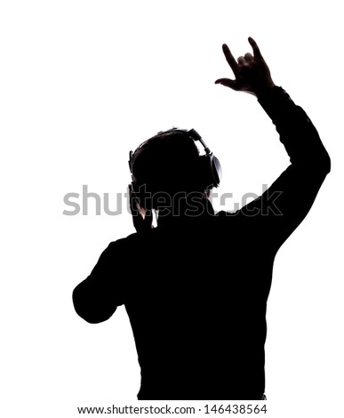 Man rocking on with headphones in silhouette isolated over white background  - stock photo