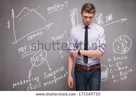 man rolling up their sleeves after bad economic forecast - stock photo