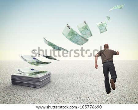man run and try to reach money