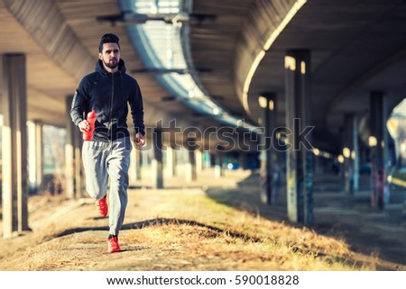 Man Runner Under Bridge in the City