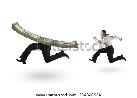 Man running after money with human legs, isolated on white background. - stock photo