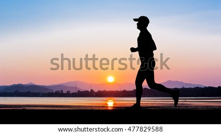 Man running at seaside twilight time in Thailand Asia