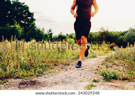 Man running during sunset - stock photo