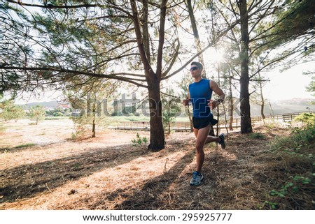 Man running in a forest outdoors. Man is training