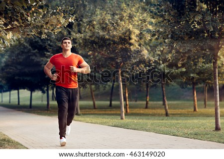 Man Running in Outdoor Jogging Training Routine - Handsome sportsman in active lifestyle moment