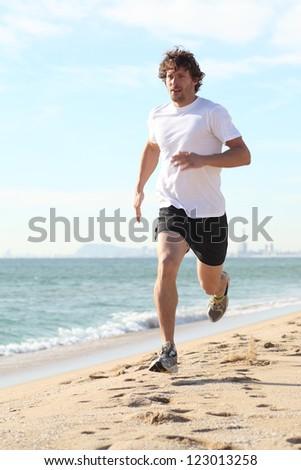 Man running in the beach. Diagonal view - stock photo