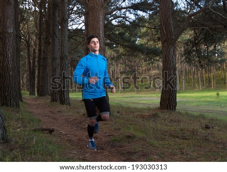 Man running in the forest outdoors