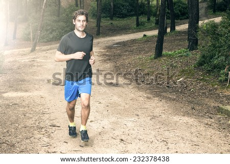 Man running in the park - stock photo