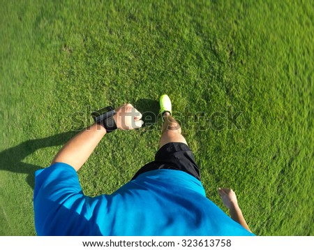 Man running on grass. movement  shot. - stock photo