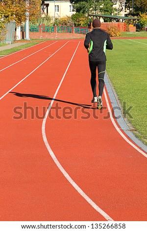 Man running on the treadmill - stock photo