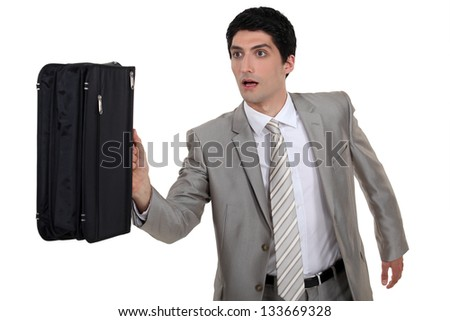 Man running with briefcase - stock photo