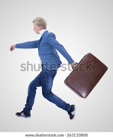 man running with suitcase on white background - stock photo