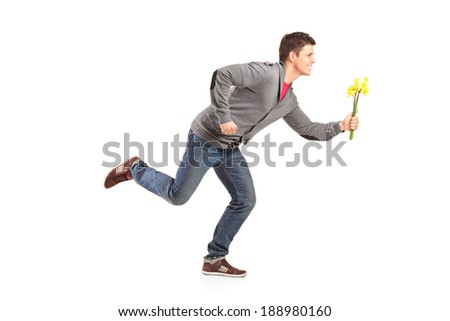 Man running with yellow tulips in hand isolated on white background - stock photo