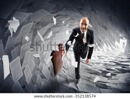 Man runs away from a paperwork wave - stock photo